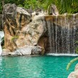 Swimming pool with waterfall and slide at high resolution — Stock Photo #25113161