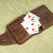 Royalty-Free Stock Photo: Purse made of leather and playing cards