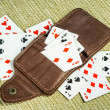 Purse made of leather and playing cards — Stock Photo