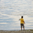 Stock Photo: Child catches fish in lake
