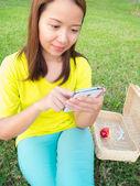 Woman play smartphone — Stock Photo