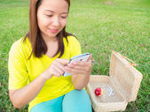 Woman play smartphone — Stock Photo