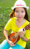 Woman play ukulele — Stock Photo