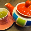 Green tein colorful cup and teapot — Stock Photo #39053355