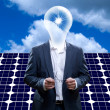 Idea man in front of a solar panel — Stock Photo #22848470