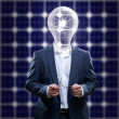 Idea man in front of a solar panel — Stock Photo