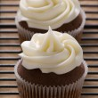 Chocolate gourmet cupcakes with cream cheese frosting — Stock Photo #22849892