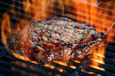 Steak on Flaming grill — Stock Photo