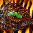 Rib Eye Steak On A Hot Flaming Grill — Stock Photo