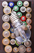 Flow lamp and batteries background — Stock Photo