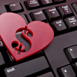 Red heart with a dollar sign — Stock Photo #24258445