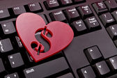 Red heart with a dollar sign — Stock Photo