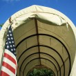 Covered Wagon With Flag — Stok Fotoğraf #23544595
