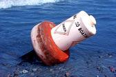 Bóia de perigo derrubada — Fotografia Stock