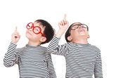 Two brother smiling and raising his finger — Stock Photo