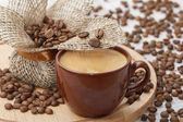 Cup of coffee and coffee grains — Photo