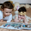 Children look the magazine — Stock Photo