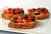 Bruschetta on white plate 2 — Stock Photo