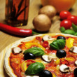 图库照片: Closeup from pizza, oil and ingredients