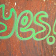"Stock Photo: ""yes"" wrote on rusty background"