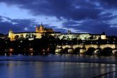 Blue hour at the charles bridge and the prague castle in autumn — Stock Photo