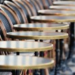 Row of chairs and tables — Stock Photo
