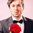 Man in love with roses — Stock Photo