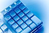Keyboard in blue ambiance — Stock Photo