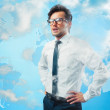Businessman in the clouds with worldmap symbolizes cloud-computing — Foto Stock