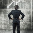 Businessman in front of a wall  — Stock Photo