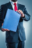 Businessman holding application folder — Stock Photo