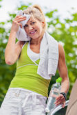 Senior after sports dries with a towel — Stock Photo
