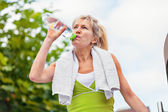 Senior woman holding a water bottle — Stock Photo