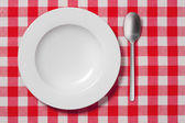 Empty plates on a table — Stock Photo