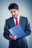 Businessman holding application folder — Stock Photo