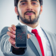 Businessman holding a smartphone — Stock Photo