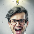 Businessman with light bulb - Stock Photo