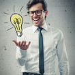 Businessman with light bulb — Stockfoto