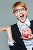 Smart business woman and her piggy bank — Stock Photo