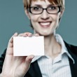 Young business woman showing her business card — Stock Photo #30156245
