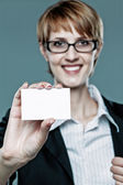 Young business woman showing her business card — Foto Stock