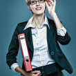 Smart business woman carrying folder with documents — Stock Photo