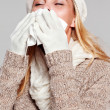 Woman holding a handkerchief and sneezing — Foto Stock