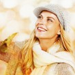 Woman enjoying nature in autumn fashion — Stock Photo