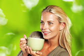 Woman enjoying a mug of tea — Stock Photo