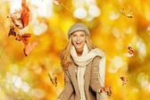 Woman having fun with some foliage outdoors — Stock Photo
