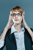 Business woman focusing herself with hands on her spectacles — Stock Photo