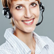 Woman with headset smiling  — Stock Photo