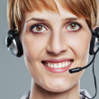Close up of female operator with headset — Stock Photo