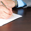Stock Photo: Writting on empty sheet of paper